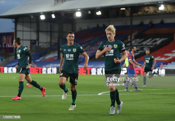 Ben Mee of Burnley celebrates with Jack Cork after scoring his team's first goal during the Premier League match between Crystal Palace and Burnley...