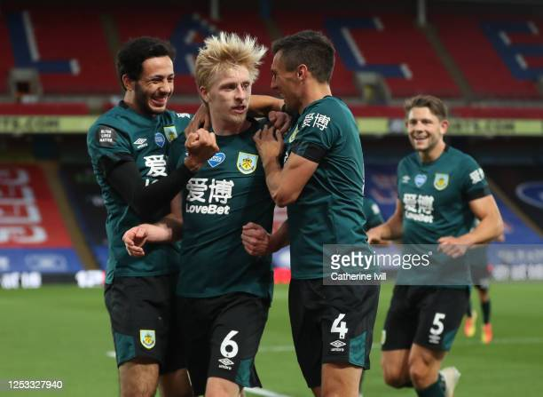 Ben Mee of Burnley celebrates with Jack Cork and Dwight McNeil after scoring his team's first goal during the Premier League match between Crystal...