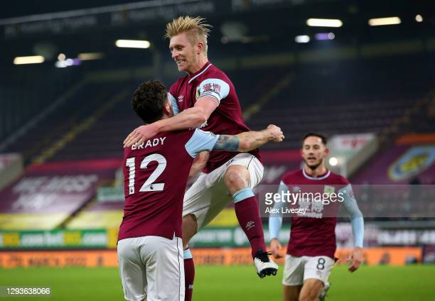 Ben Mee of Burnley celebrates with teammate Robbie Brady after scoring his team's first goal during the Premier League match between Burnley and...
