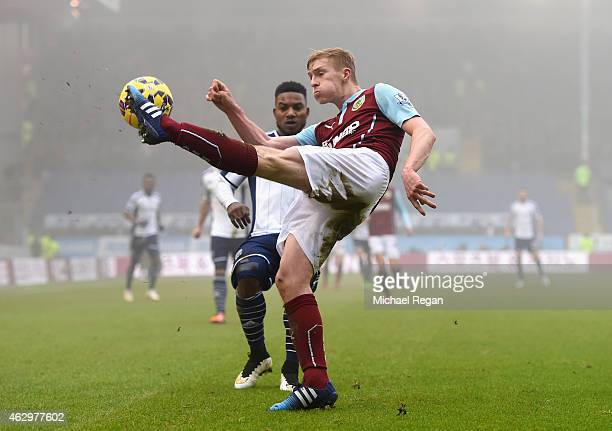 Ben Mee of Burnley clears the danger during the Barclays Premier League match between Burnley and West Bromwich Albion at Turf Moor on February 8...
