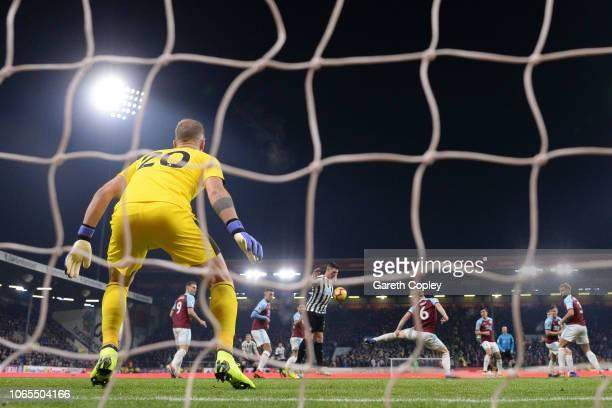 Ben Mee of Burnley delects a shot by Federico Fernandez of Newcastle United for their first goal past Joe Hart of Burnley during the Premier League...