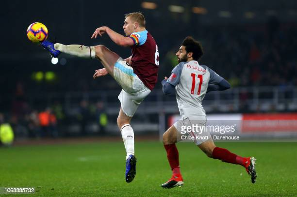 Ben Mee of Burnley FC and Mohamed Salah of Liverpool in action during the Premier League match between Burnley FC and Liverpool FC at Turf Moor on...