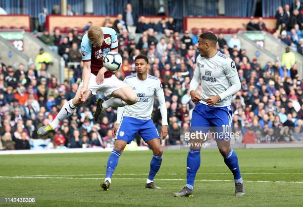 Ben Mee of Burnley handles the ball in the area during the Premier League match between Burnley FC and Cardiff City at Turf Moor on April 13 2019 in...