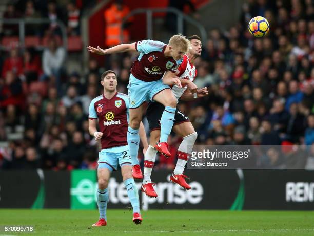 Ben Mee of Burnley heads the ball away from Manolo Gabbiadini of Southampton during the Premier League match between Southampton and Burnley at St...