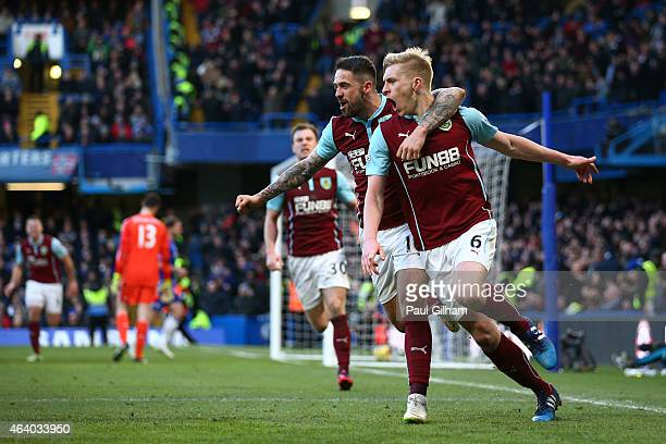 Ben Mee of Burnley is congratulated by teamate Danny Ings of Burnley after scoring a goal to level the scores at 11 during the Barclays Premier...