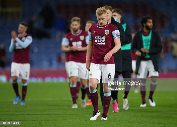 Ben Mee of Burnley looks dejected as he leaves the pitch with team mates following the Premier League match between Burnley and Liverpool at Turf...