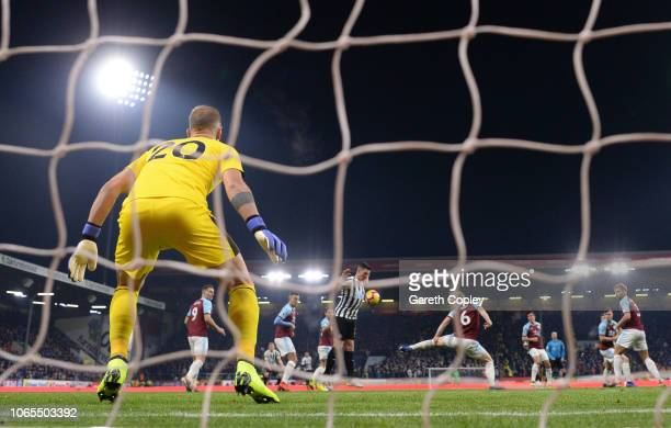 Ben Mee of Burnley scores an own goal during the Premier League match between Burnley FC and Newcastle United at Turf Moor on November 26 2018 in...