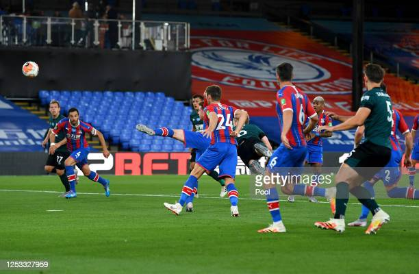 Ben Mee of Burnley scores his team's first goal during the Premier League match between Crystal Palace and Burnley FC at Selhurst Park on June 29,...