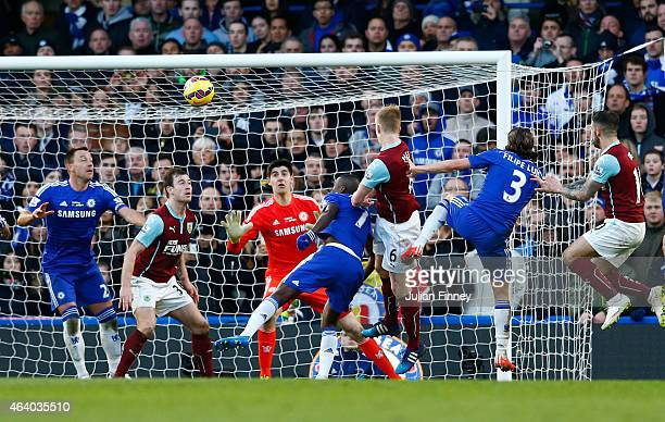 Ben Mee of Burnley scores the equalising goal with a header during the Barclays Premier League match between Chelsea and Burnley at Stamford Bridge...