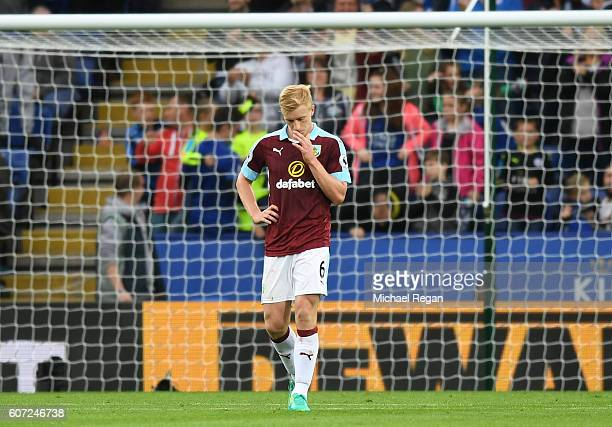 Ben Mee of Burnley shows defection after scoring a own goal during the Premier League match between Leicester City and Burnley at The King Power...