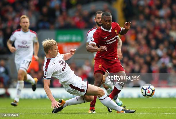 Ben Mee of Burnley tackles Daniel Sturridge of Liverpool during the Premier League match between Liverpool and Burnley at Anfield on September 16...