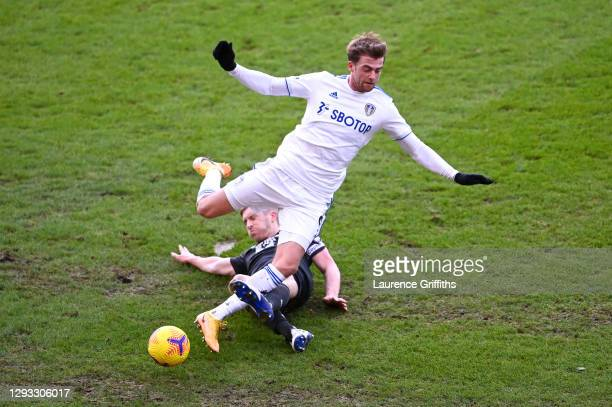 Ben Mee of Burnley tackles Patrick Bamford of Leeds United during the Premier League match between Leeds United and Burnley at Elland Road on...