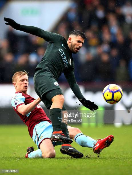 Ben Mee of Burnley tackles Sergio Aguero of Manchester City during the Premier League match between Burnley and Manchester City at Turf Moor on...