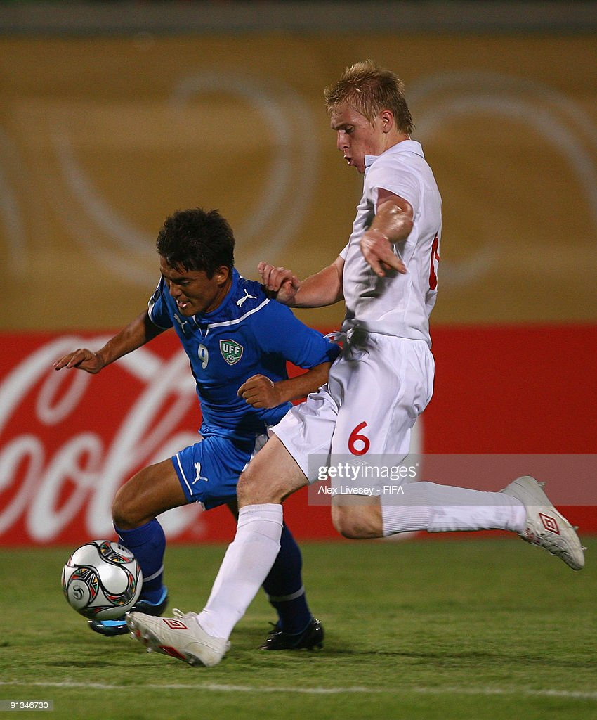 Ben Mee of England tackles Kenja Turaev of Uzbekistan during the FIFA U20 World Cup Group D match between Uzbekistan and England at the Mubarak Stadium on October 2, 2009 in Suez, Egypt.