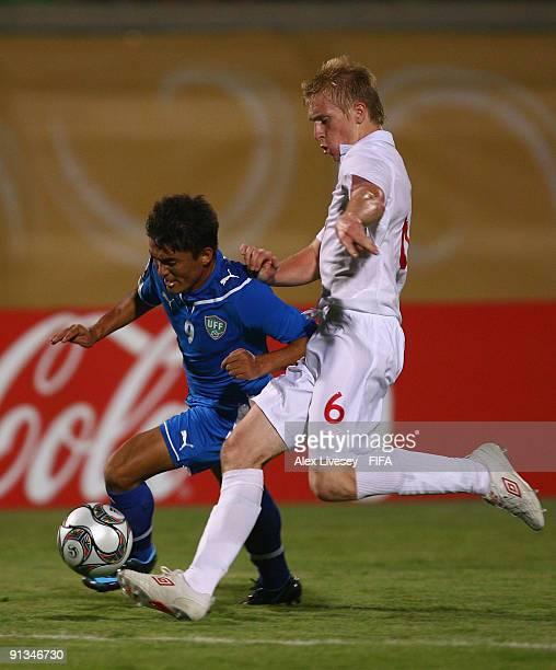 Ben Mee of England tackles Kenja Turaev of Uzbekistan during the FIFA U20 World Cup Group D match between Uzbekistan and England at the Mubarak...