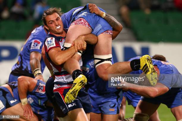Ben Meehan of the Rebels tackles Lewis Carmichael of the Force during the round 16 Super Rugby match between the Force and the Rebels at nib Stadium...