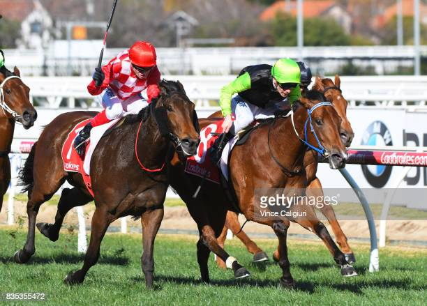 Ben Melhalm riding Crown Witness defeats Craig Williams riding Catchy in Race 5 Quezette Stakes during Melbourne Racing at Caulfield Racecourse on...