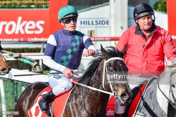 Ben Melham returns to the mounting yard aboard Eurack after winning the Comcater Handicap at Ladbrokes Park Hillside Racecourse on July 26 2017 in...