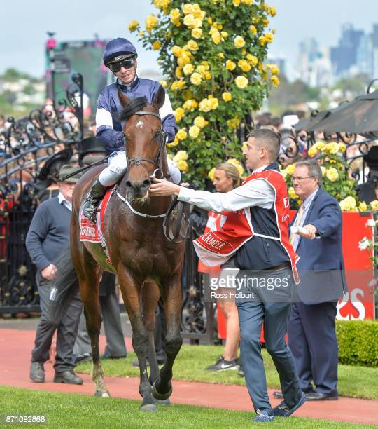 Ben Melham returns to the mounting yard aboard Johannes Vermeer after the Emirates Melbourne Cup at Flemington Racecourse on November 07 2017 in...
