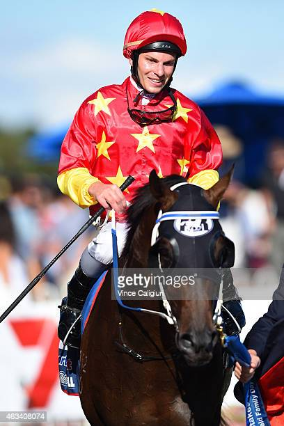Ben Melham riding Dissident after winning Race 8 the William Hill CFOrr Stakes during Melbourne Racing at Caulfield Racecourse on February 14 2015 in...