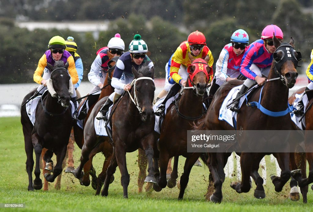 Ben Melham riding Eurack (Green white checked cap) turns into the home straight before winning Race 6 during Melbourne Racing at Sandown Hillside on August 23, 2017 in Melbourne, Australia.