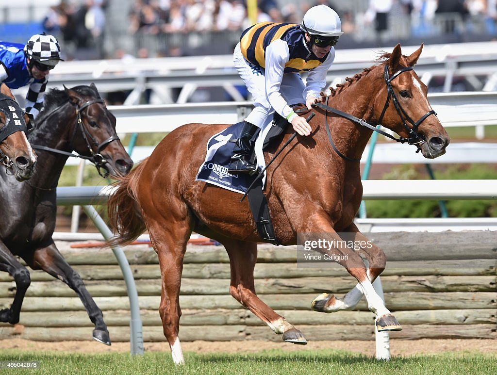 Ben Melham riding Gailo Chop wins Race 6, the Longines MacKinnon Stakes on Derby Day at Flemington Racecourse on October 31, 2015 in Melbourne, Australia.