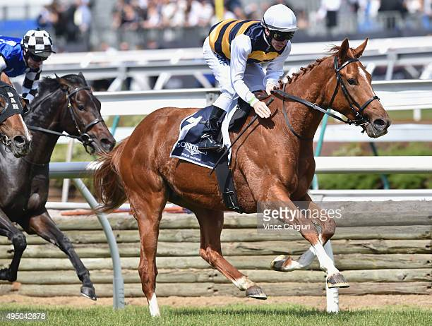 Ben Melham riding Gailo Chop wins Race 6 the Longines MacKinnon Stakes on Derby Day at Flemington Racecourse on October 31 2015 in Melbourne Australia