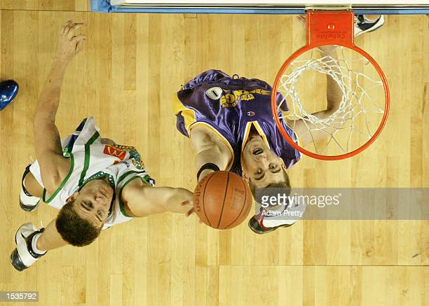 Ben Melmeth of the Kings grabs a rebound over Andrew Rice of the Crocs during the NBL round 4 match between the Sydney Kings and the Townsville...