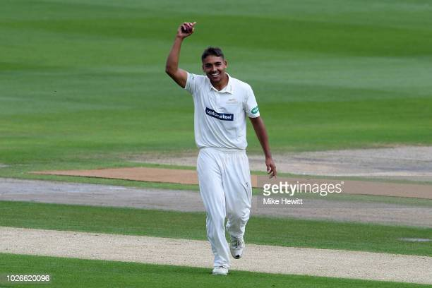 Ben Mike of Leicestershire celebrates after taking his maiden first class wicket catching Phil Salt of Sussex off his own bowling during the...