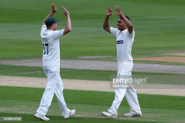 Ben Mike of Leicestershire celebrates with team mate Neil Dexter after taking his maiden first class wicket catching Phil Salt of Sussex off his own...
