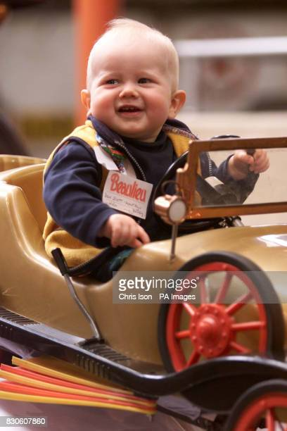 Ben Montagu Scott the 10 month old grandson of Lord Montagu of Beaulieu officially opening the Motoring Thru Childhood exhibition at The National...