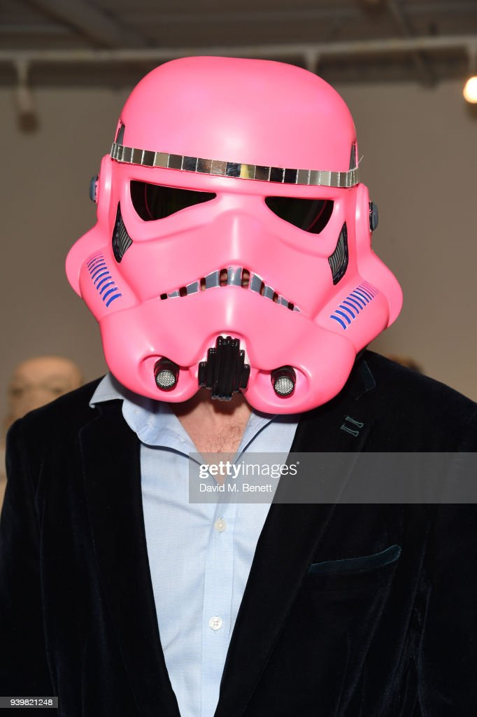 Ben Moore models artwork at a private view of Art Wars East at Hix Art on March 29, 2018 in London, England.