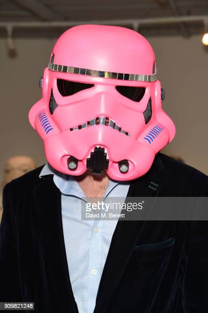 Ben Moore models artwork at a private view of Art Wars East at Hix Art on March 29 2018 in London England