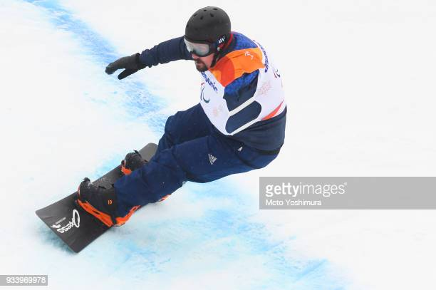 Ben Moore of Great Britain competes in the Snowboard Men's Banked Slalom SBUL Run 2 on day seven of the PyeongChang 2018 Paralympic Games on March 16...
