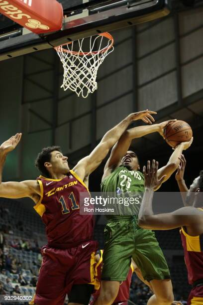Ben Moore of the Fort Wayne Mad Ants battles Grant Jerrett the Canton Charge on March 16 2018 at Memorial Coliseum in Fort Wayne Indiana NOTE TO USER...