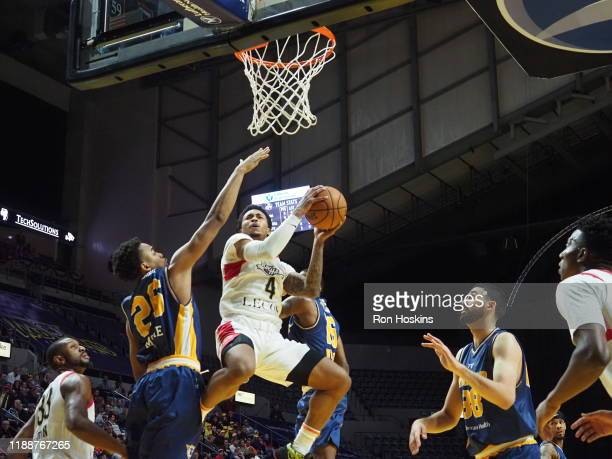 Ben Moore of the Fort Wayne Mad Ants battles Jalen Adams of the Erie Bayhawks on December 14 2019 at Memorial Coliseum in Fort Wayne Indiana NOTE TO...