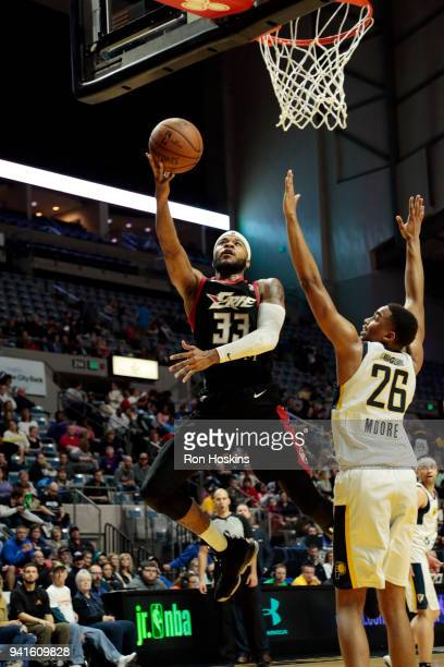Ben Moore of the Fort Wayne Mad Ants battles Jeremy Hollowell of the Erie Bayhawks in the 2018 Eastern Conference semifinals of the NBA G League on...