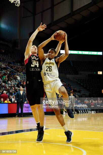 Ben Moore of the Fort Wayne Mad Ants battles Tyler Cavanaugh of the Erie Bayhawks in the 2018 Eastern Conference semifinals of the NBA G League on...