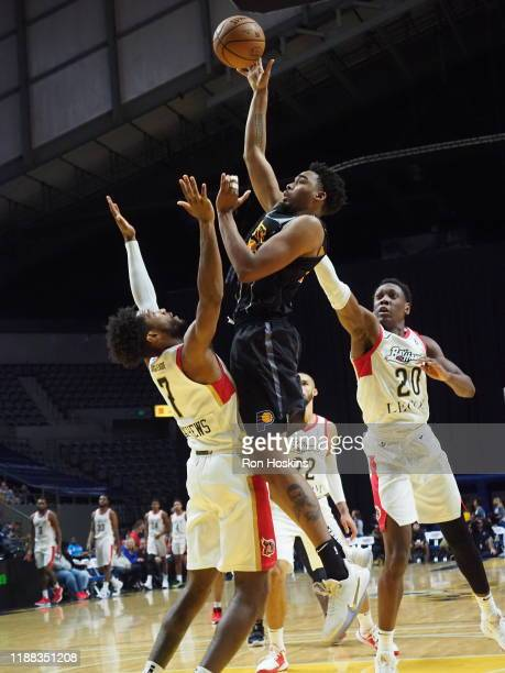 Ben Moore of the Fort Wayne Mad Ants shoots the ball against EC Matthews # and Scottie Lindsey of the Erie Bayhawks on December 13 2019 at Memorial...