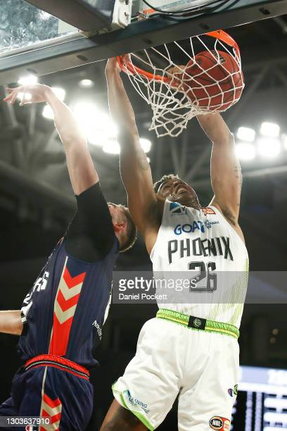 Ben Moore of the Phoenix dunks the ball during the NBL Cup match between the Adelaide 36ers and the South East Melbourne Phoenix at John Cain Arena...