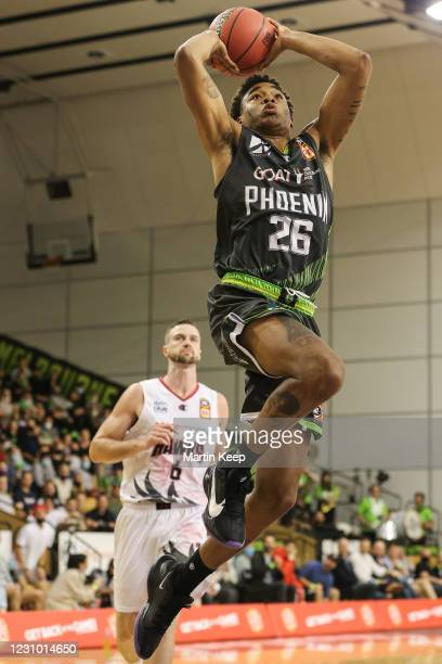 Ben Moore of the Phoenix dunks the ball during the round four NBL match between the South East Melbourne Phoenix and the Illawarra Hawks at the State...