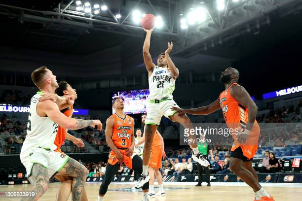 Ben Moore of the Phoenix shoots during the NBL Cup match between the Cairns Taipans and the South East Melbourne Phoenix at John Cain Arena on March...