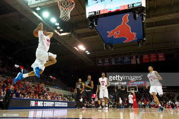 Ben Moore of the SMU Mustangs dunks the ball against the Temple Owls on February 6 2014 at Moody Coliseum in Dallas Texas