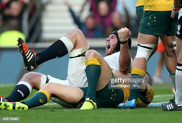 Ben Morgan of England celebrates after scoring the opening try during the QBE international match between England and Australia at Twickenham Stadium...