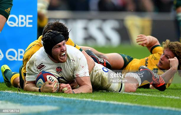 Ben Morgan of England crashes over to score the opening try during the QBE international match between England and Australia at Twickenham Stadium on...