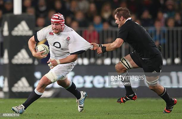 Ben Morgan of England is held by Richie McCaw during the International Test Match between the New Zealand All Blacks and England at Forsyth Barr...