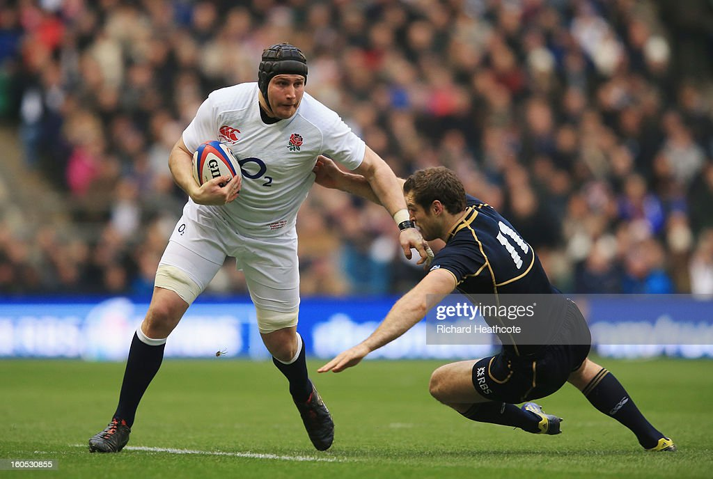 Ben Morgan of England is tackled by Tim Visser of Scotland during the RBS Six Nations match between England and Scotland at Twickenham Stadium on February 2, 2013 in London, England.