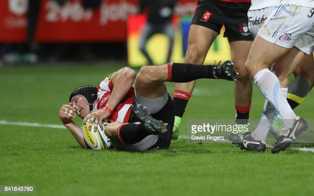 Ben Morgan of Gloucester dives onto the loose ball to score a try during the Aviva Premiership match between Gloucester Rugby and Exeter Chiefs at...