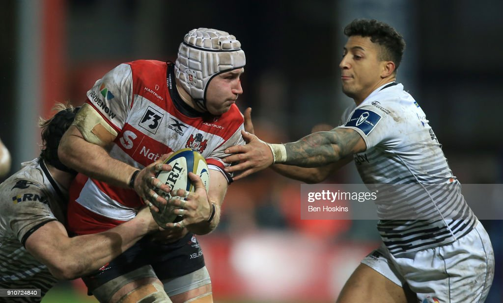 Ben Morgan of Gloucester is tackled by Jay Baker of Ospreys during the Anglo-Welsh Cup match between Gloucester Rugby and Ospreys at Kingsholm Stadium on January 26, 2018 in Gloucester, England.