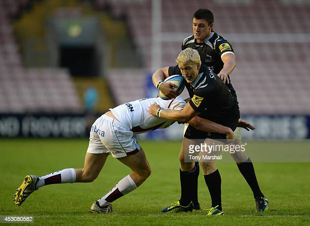 Ben Morris of Newcastle Falcons tackled byGeorge Nott of Sale Sharks during the Premiership Rugby 7's Series at The Darlington Northern Echo Arena on...